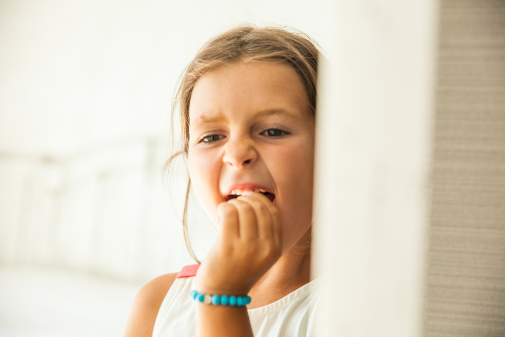 Little girl checking when the tooth will fall out