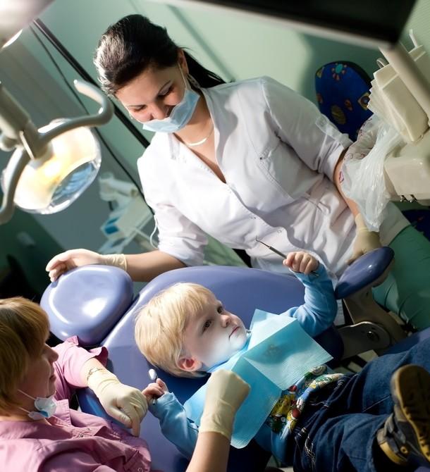 Pediatric Dentistry.  child at a reception at dentist
